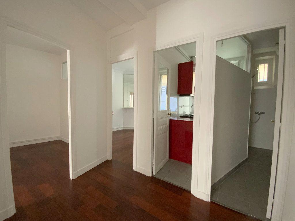 Appartement à louer 3 55.64m2 à Paris 16 vignette-5