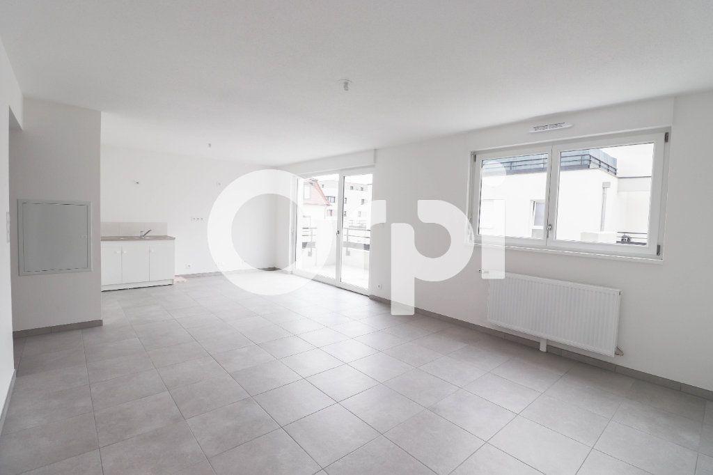 Appartement à louer 2 54.1m2 à Saint-Louis vignette-1