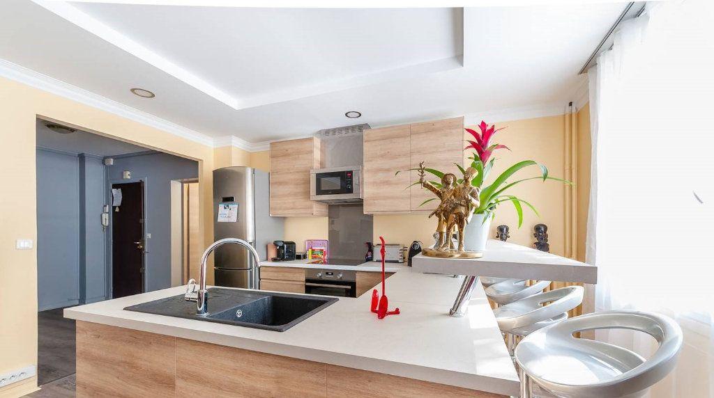Appartement à vendre 5 116.82m2 à Paris 14 vignette-1