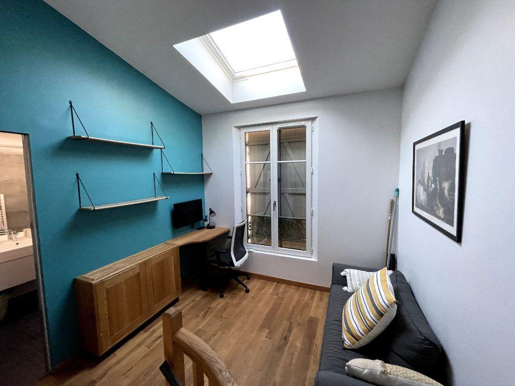 Maison à louer 3 52.83m2 à Paris 14 vignette-6