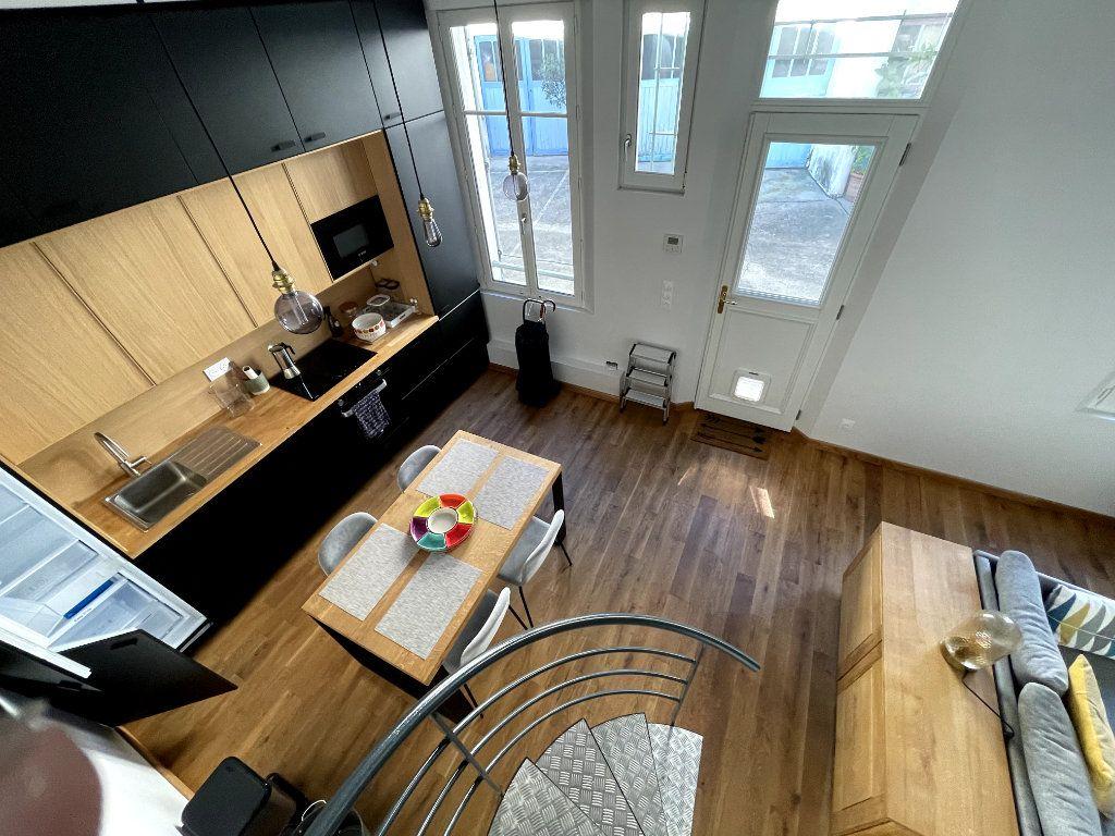 Maison à louer 3 52.83m2 à Paris 14 vignette-8