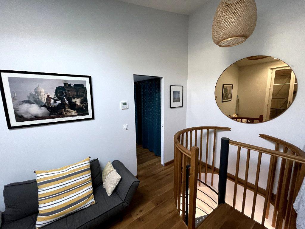 Maison à louer 3 52.83m2 à Paris 14 vignette-9