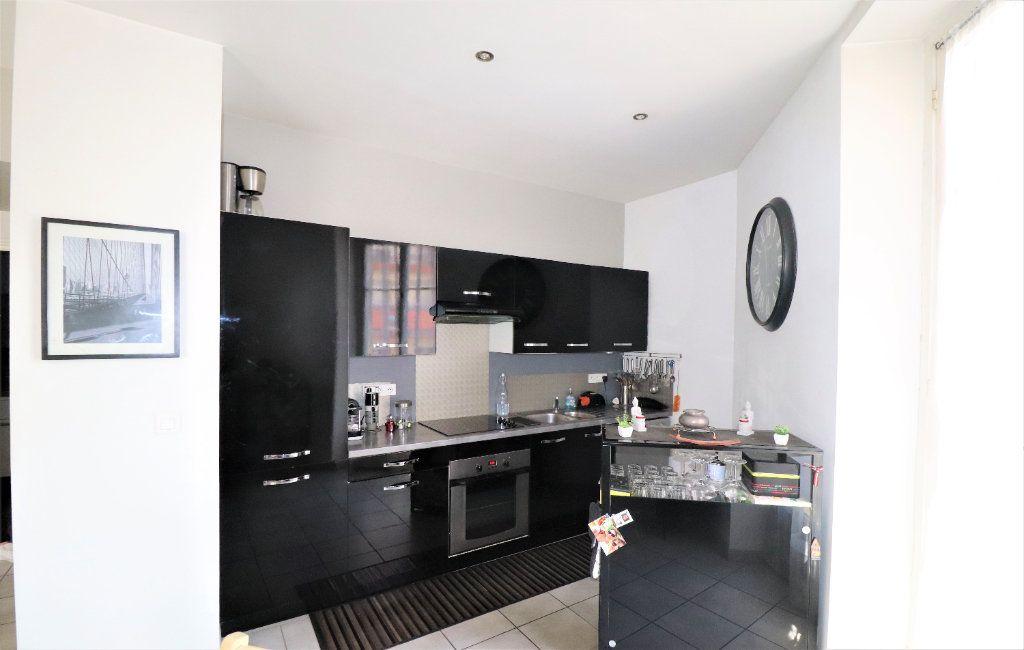 Appartement à vendre 3 57.1m2 à Nice vignette-4