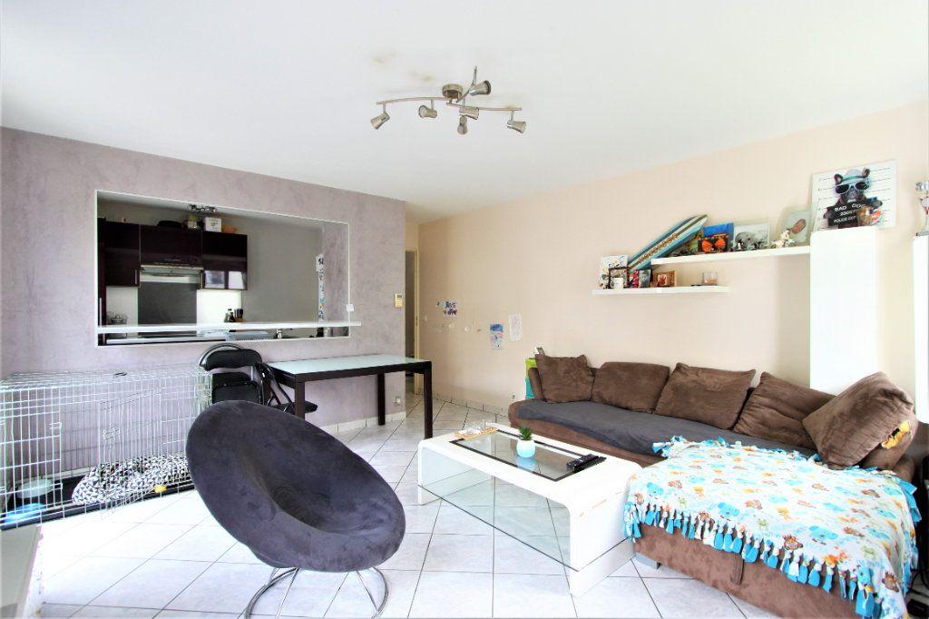 Appartement à vendre 3 64m2 à Sainte-Geneviève-des-Bois vignette-3