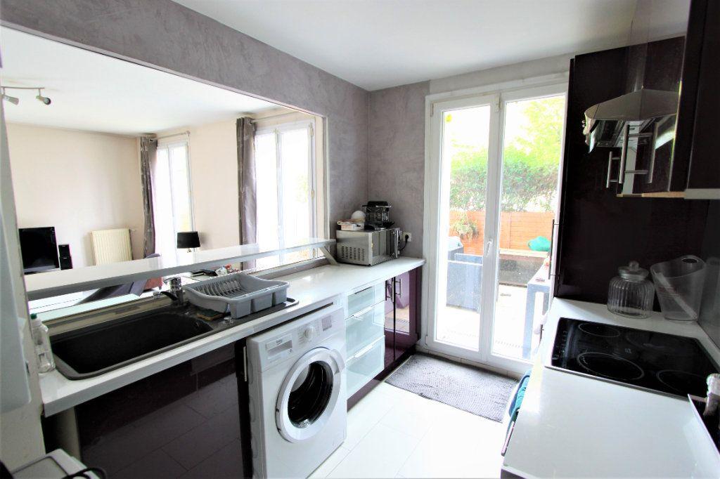 Appartement à vendre 3 64m2 à Sainte-Geneviève-des-Bois vignette-4