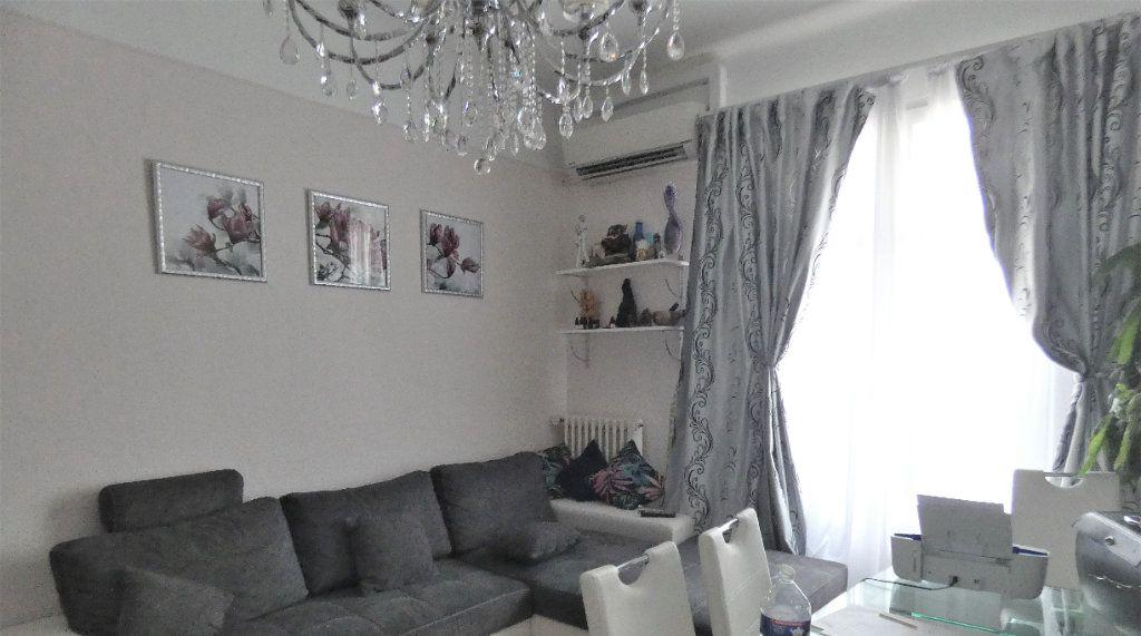 Appartement à vendre 2 57m2 à Nice vignette-4