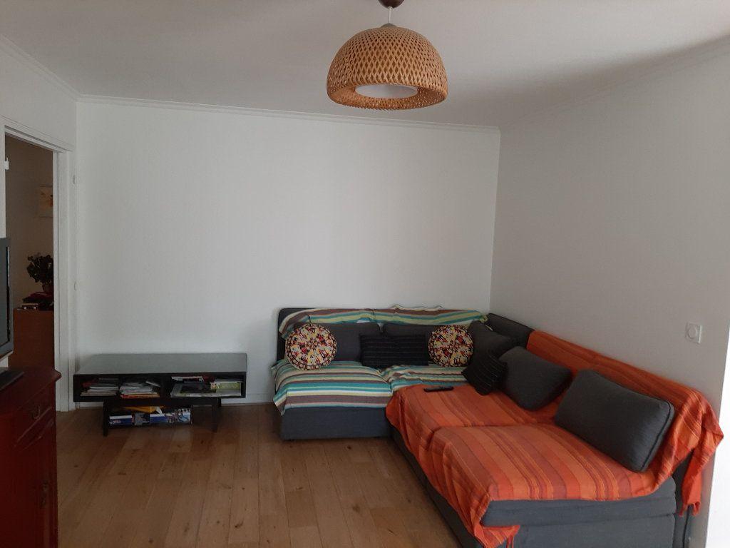 Appartement à vendre 4 86m2 à Paris 19 vignette-1
