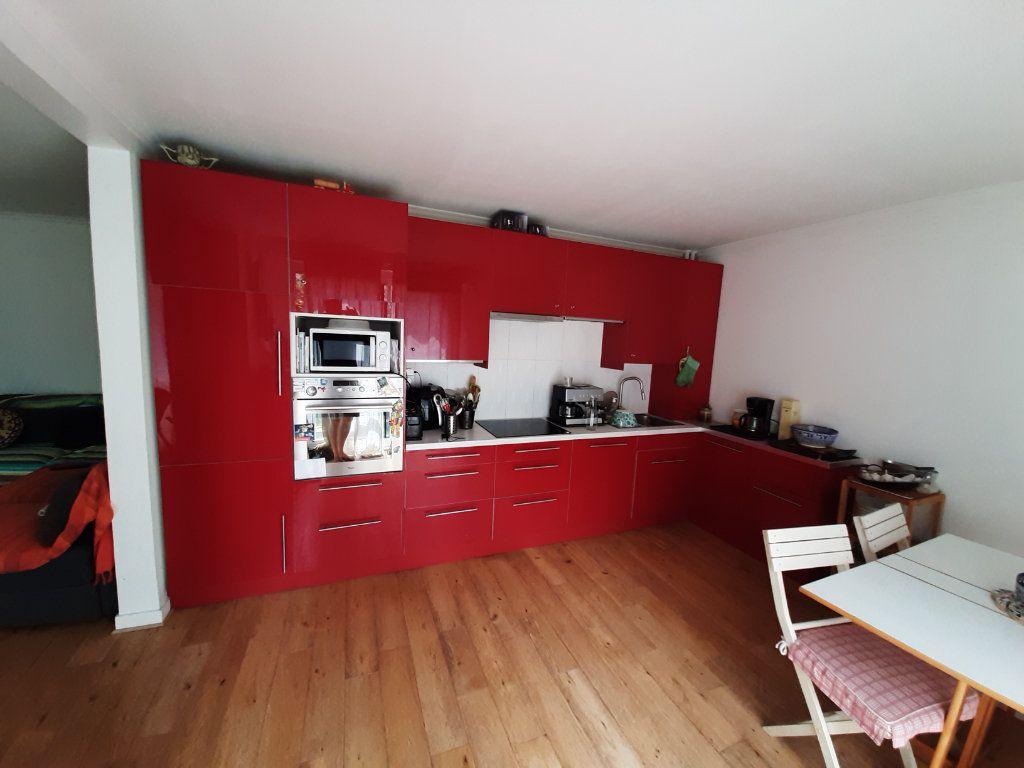 Appartement à vendre 4 86m2 à Paris 19 vignette-8
