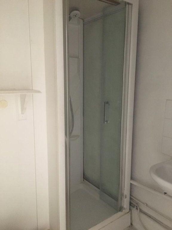 Appartement à louer 1 20.5m2 à Paris 9 vignette-3