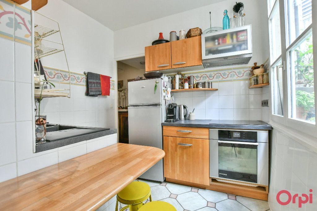Appartement à vendre 3 62.47m2 à Paris 9 vignette-5