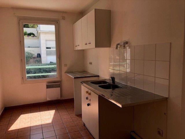 Appartement à louer 3 65.15m2 à Issy-les-Moulineaux vignette-2