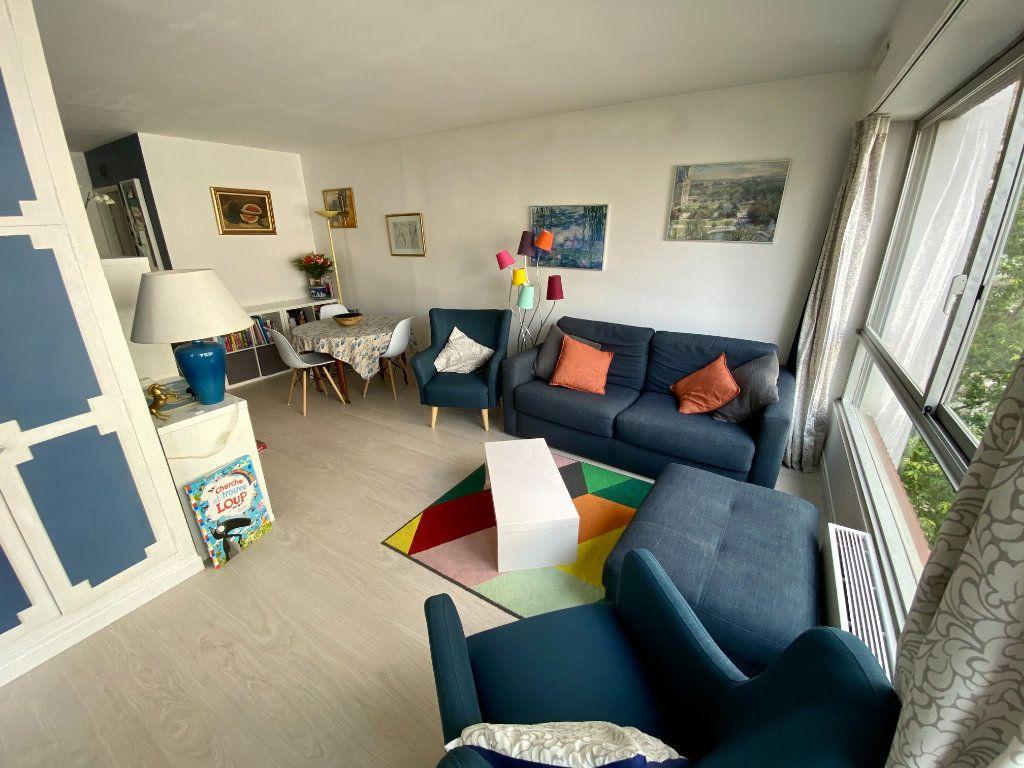 Appartement à vendre 3 67m2 à Paris 15 vignette-3