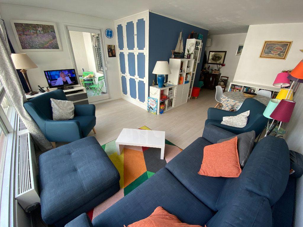 Appartement à vendre 3 67m2 à Paris 15 vignette-4