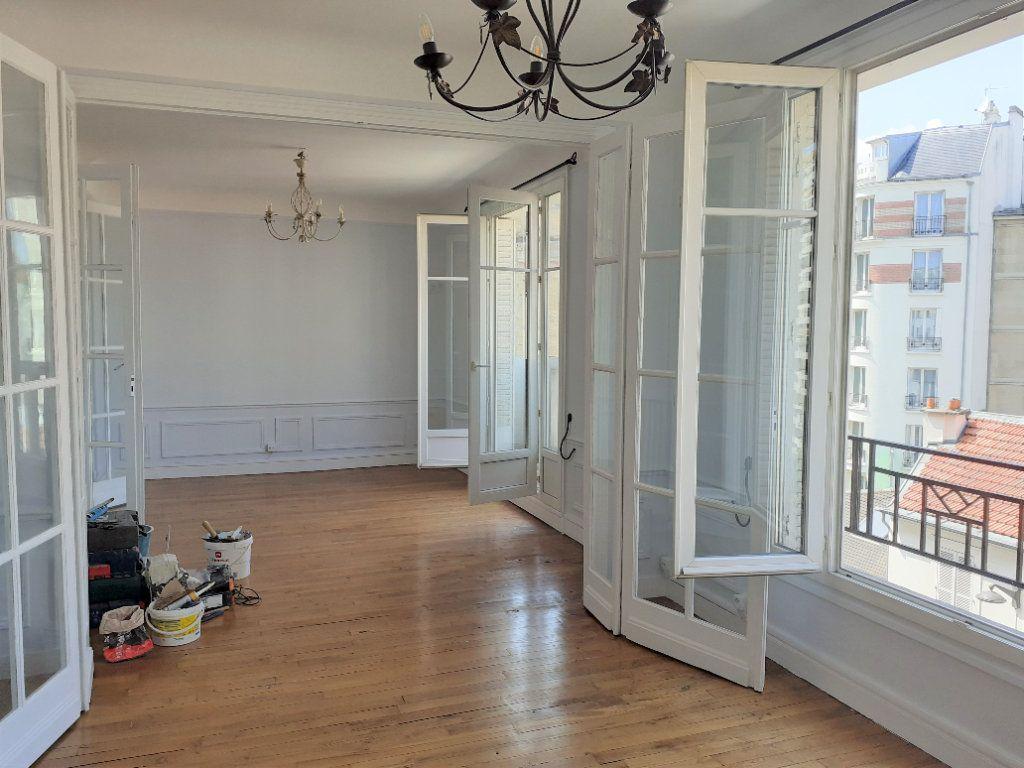 Appartement à louer 3 65.61m2 à Paris 15 vignette-2