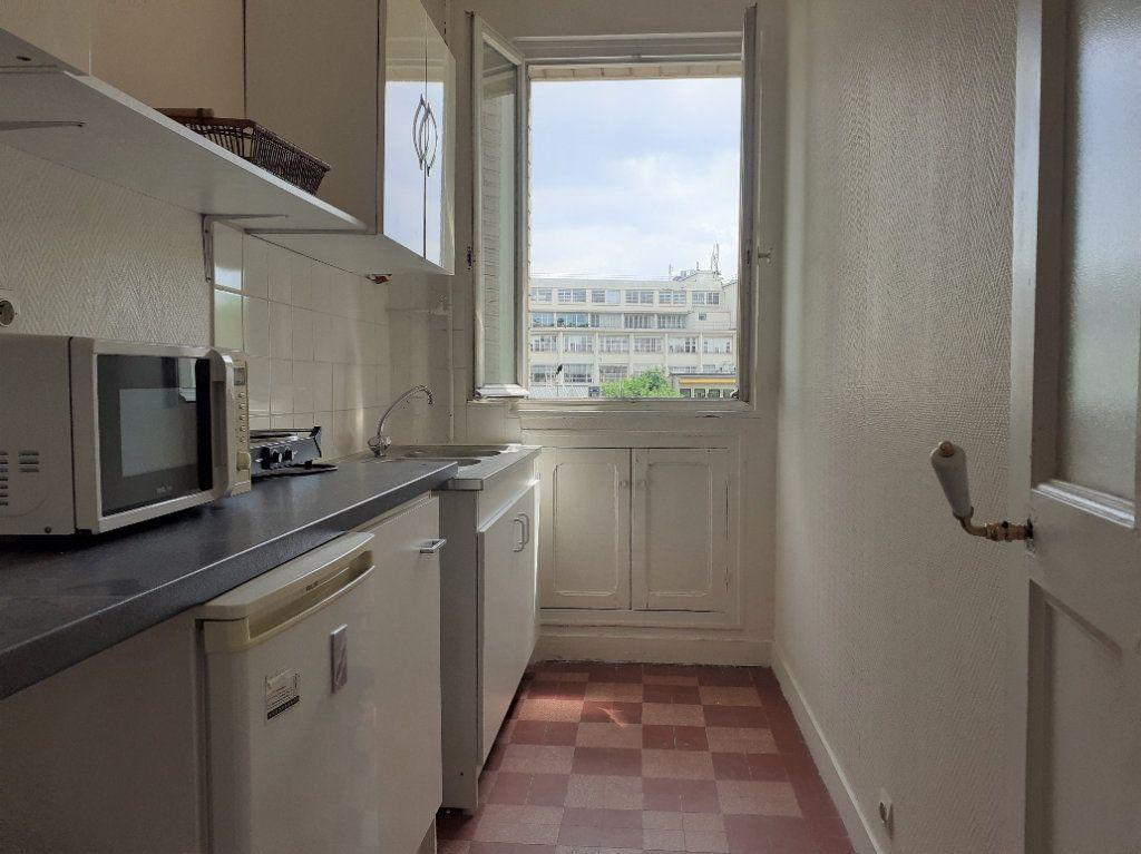 Appartement à louer 1 24.59m2 à Paris 15 vignette-4