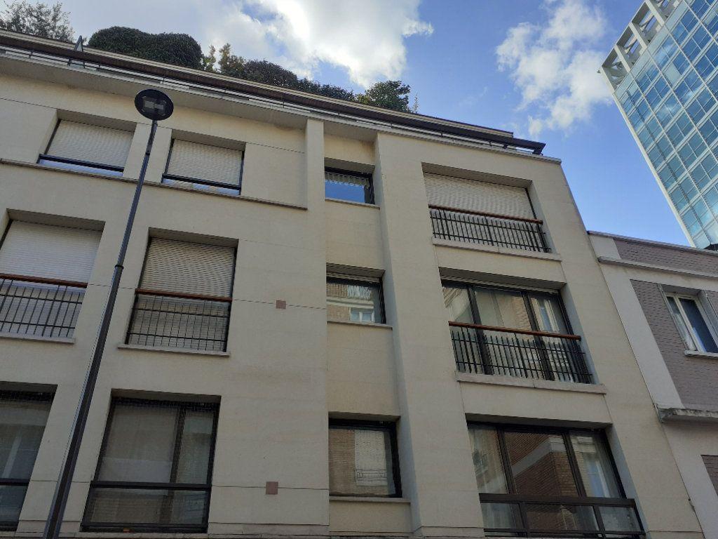 Appartement à louer 2 51.72m2 à Paris 15 vignette-1