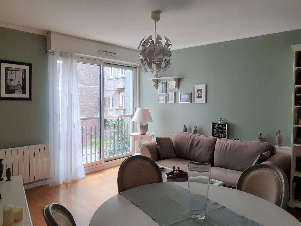 Appartement à louer 2 51.72m2 à Paris 15 vignette-3