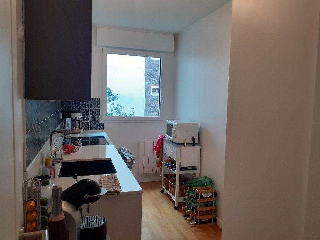 Appartement à louer 2 51.72m2 à Paris 15 vignette-5