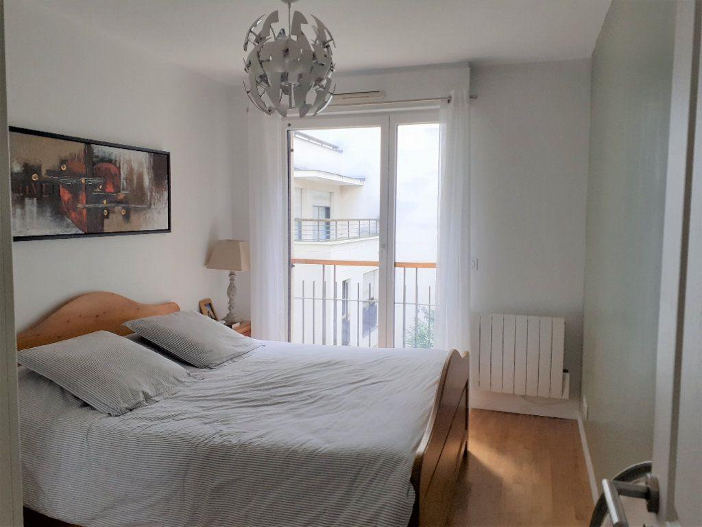 Appartement à louer 2 51.72m2 à Paris 15 vignette-6