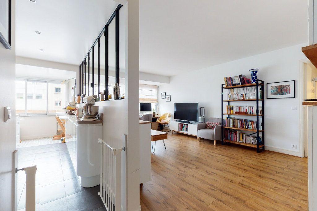 Appartement à vendre 3 71m2 à Paris 15 vignette-3