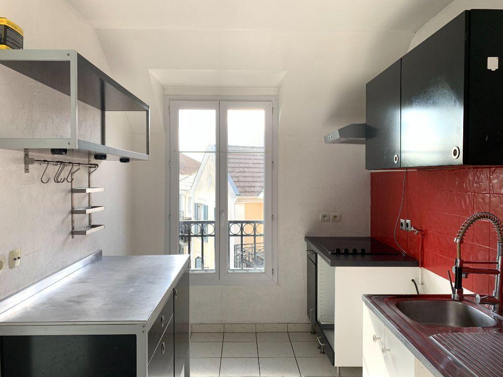 Appartement à louer 3 61.44m2 à Magny-le-Hongre vignette-3