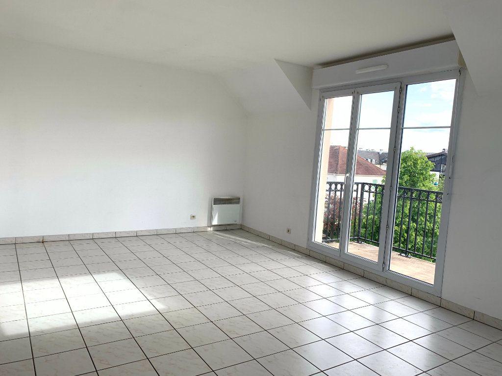 Appartement à louer 3 61.44m2 à Magny-le-Hongre vignette-6