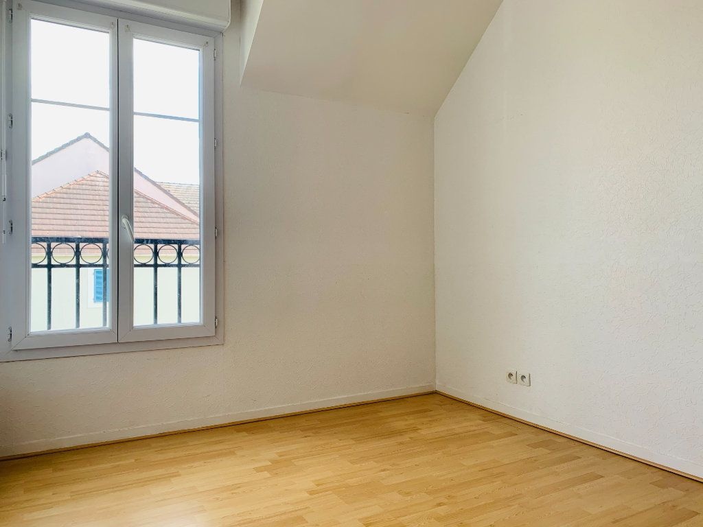 Appartement à louer 3 61.44m2 à Magny-le-Hongre vignette-9