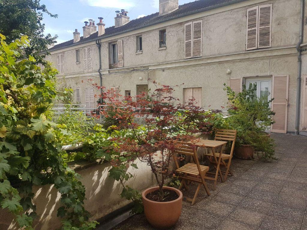 Appartement à vendre 2 45.33m2 à Paris 18 vignette-1