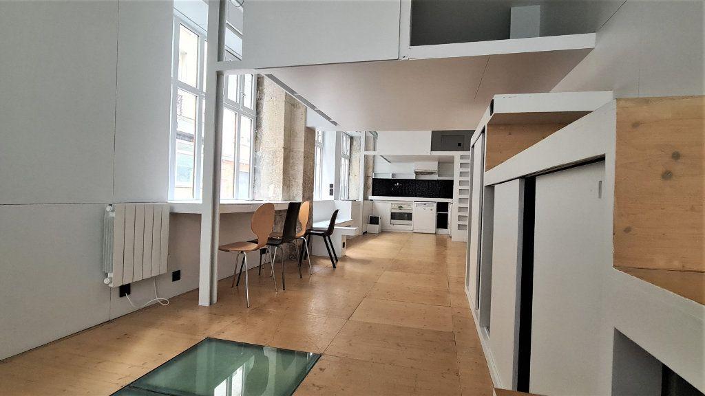 Appartement à vendre 3 49.71m2 à Paris 19 vignette-2