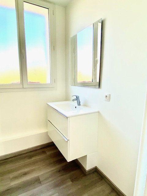 Appartement à louer 3 55.79m2 à Mézières-sur-Seine vignette-7