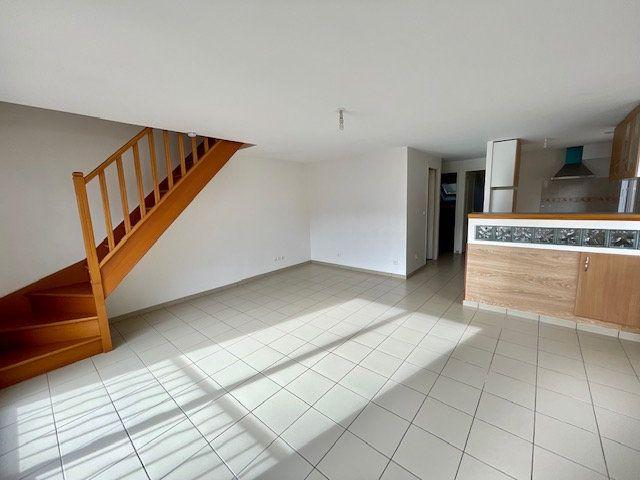 Appartement à louer 3 60.6m2 à Mézières-sur-Seine vignette-2