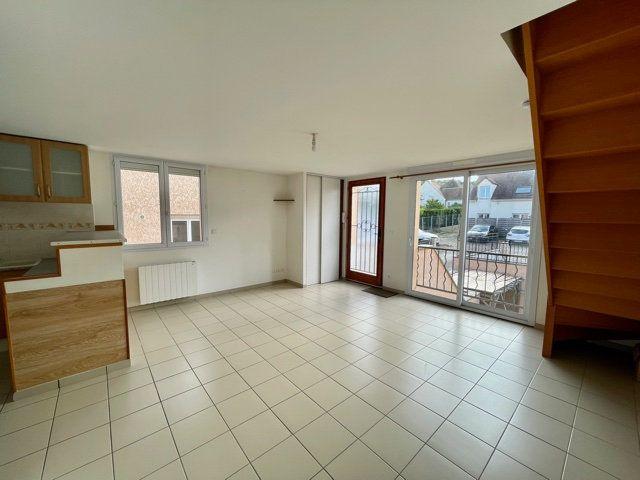 Appartement à louer 3 60.6m2 à Mézières-sur-Seine vignette-3