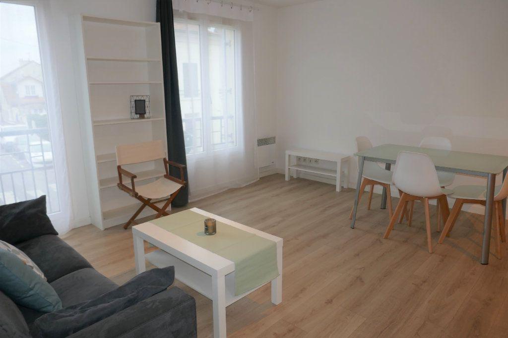 Appartement à louer 3 54m2 à Taverny vignette-2
