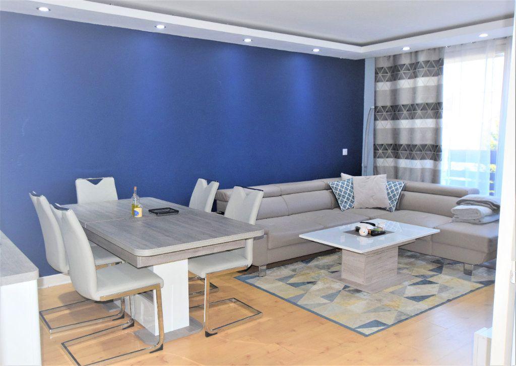 Appartement à vendre 3 70.61m2 à Saint-Michel-sur-Orge vignette-2