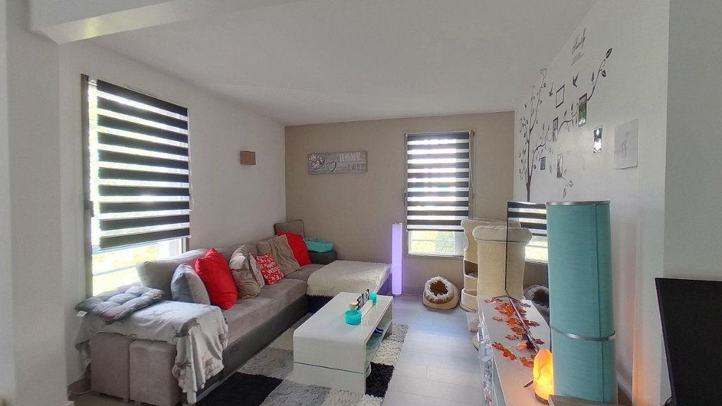 Appartement à vendre 4 79.57m2 à Sannois vignette-4