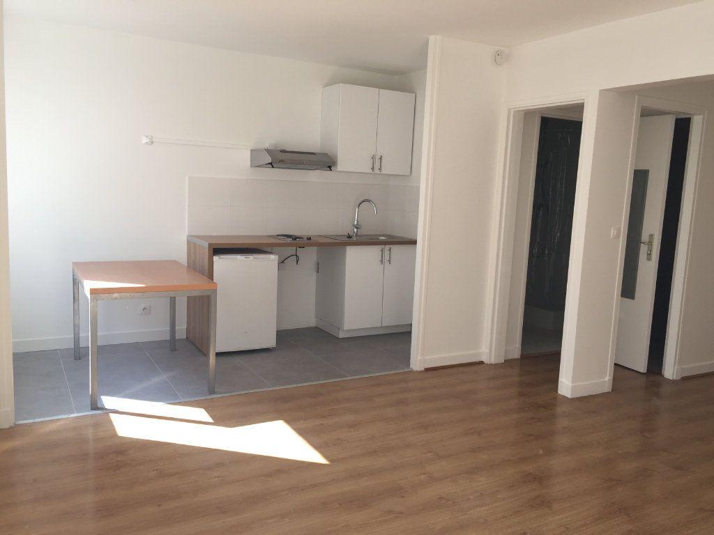 Appartement à louer 1 35.07m2 à Paris 18 vignette-6