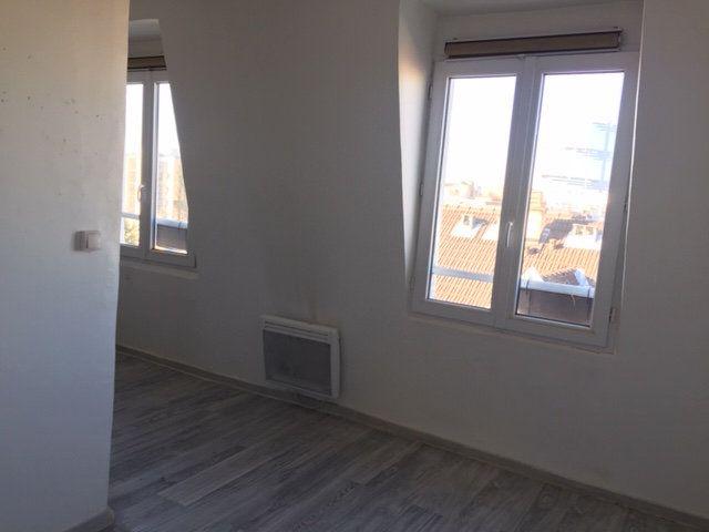 Appartement à louer 1 16.05m2 à Paris 17 vignette-1