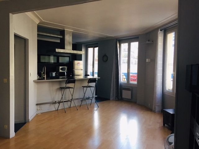 Appartement à louer 3 60.64m2 à Paris 17 vignette-1