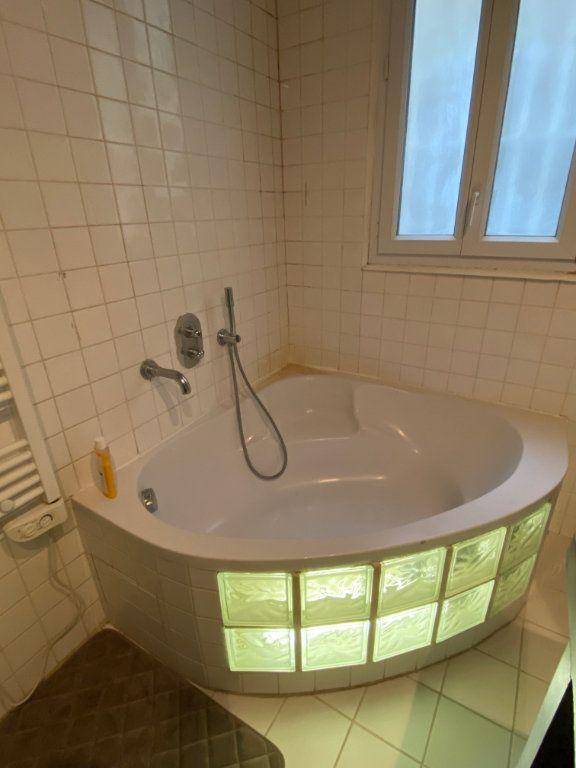 Appartement à louer 3 60.64m2 à Paris 17 vignette-4