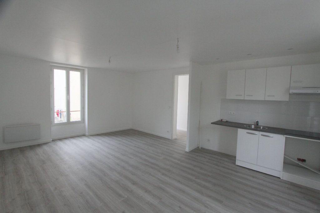 Appartement à louer 3 56.4m2 à Les Mureaux vignette-1