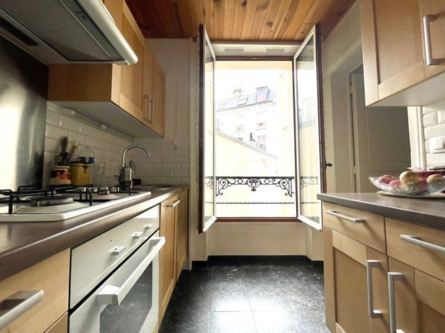 Appartement à vendre 3 60.3m2 à Paris 10 vignette-3