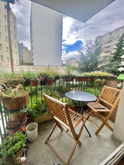 Appartement à vendre 3 71.75m2 à Paris 19 vignette-1