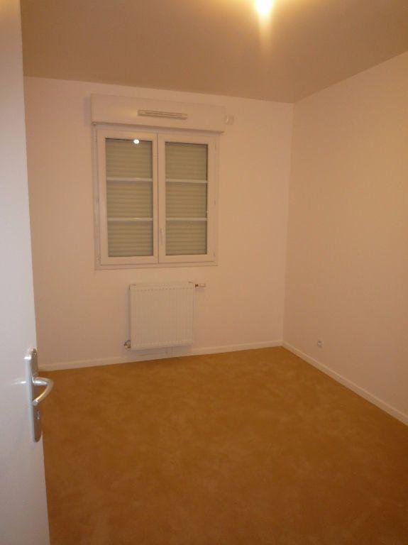 Appartement à louer 3 57.93m2 à Magny-le-Hongre vignette-3