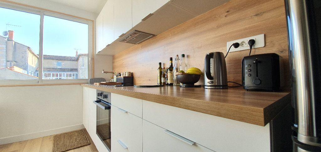 Appartement à vendre 3 53.7m2 à La Rochelle vignette-9
