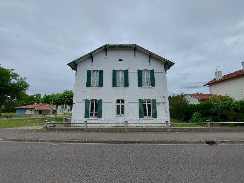 Maison à vendre 8 143.58m2 à Rion-des-Landes vignette-1