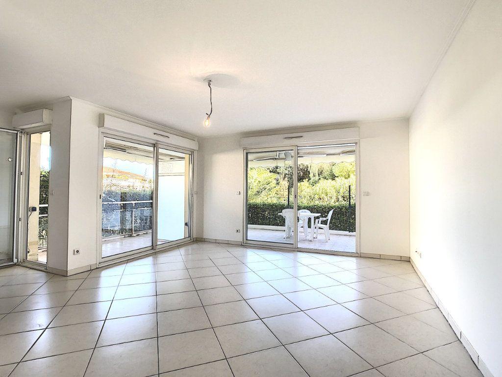 Appartement à vendre 3 68.65m2 à Antibes vignette-4