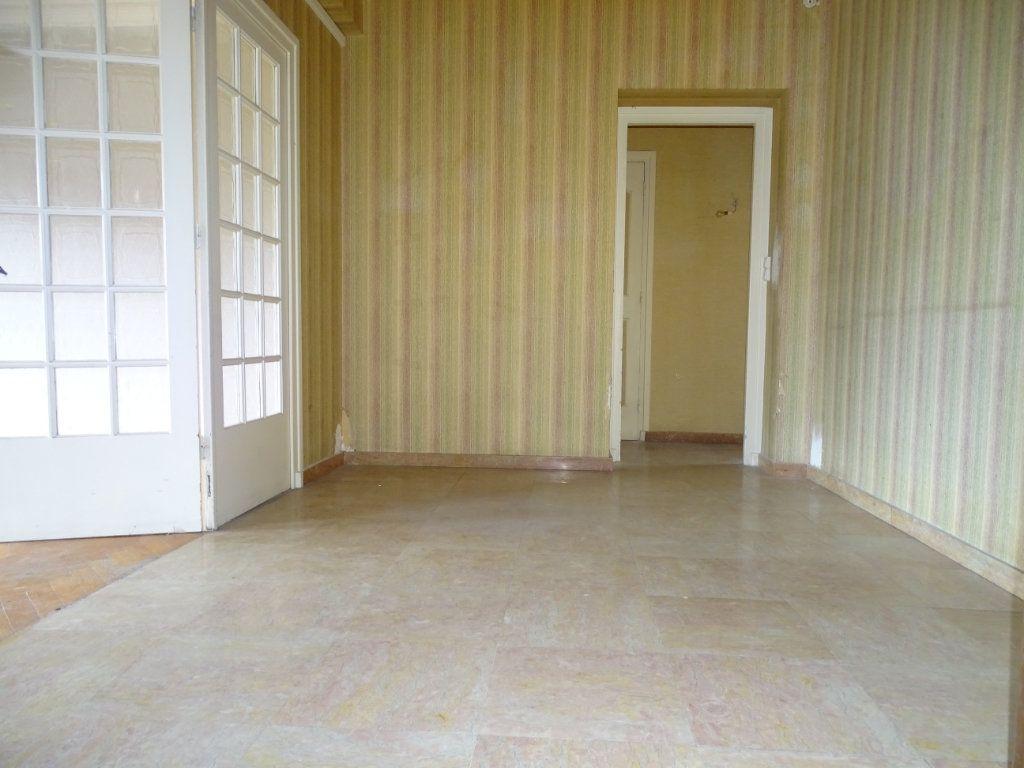 Appartement à vendre 5 122.3m2 à Saint-Étienne vignette-6