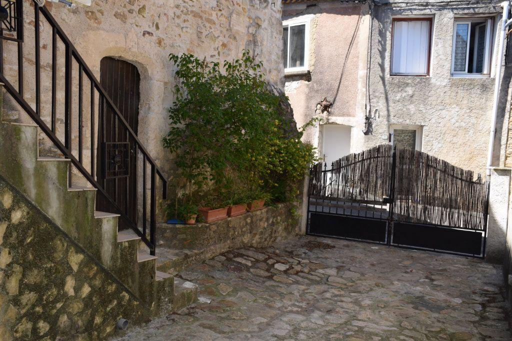 Maison à vendre 5 104m2 à Saint-Julien-de-Peyrolas vignette-1