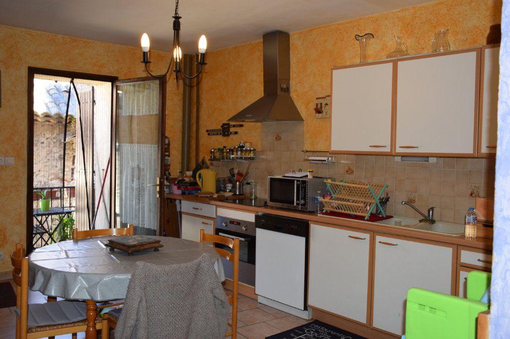 Maison à vendre 5 104m2 à Saint-Julien-de-Peyrolas vignette-7