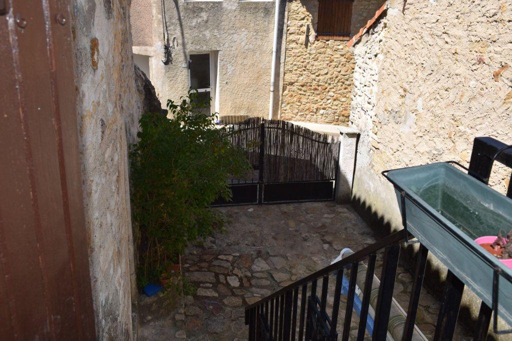 Maison à vendre 5 104m2 à Saint-Julien-de-Peyrolas vignette-9